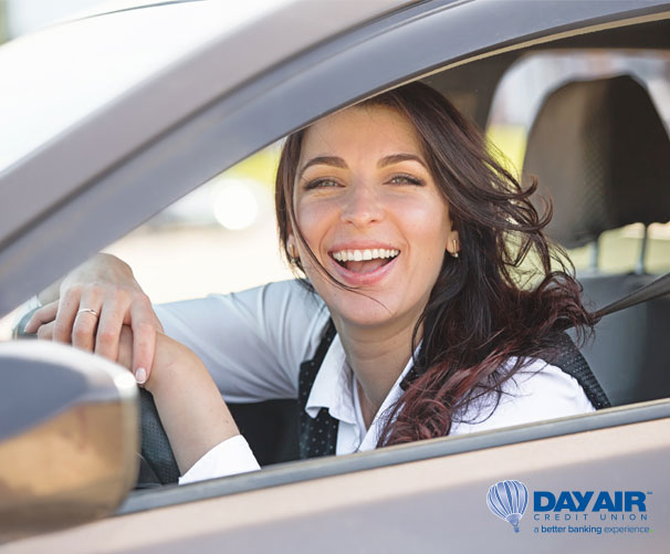 Woman smiling driving a car