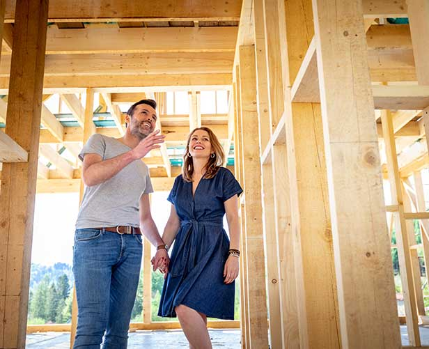 Couple looking at new construction of their house.